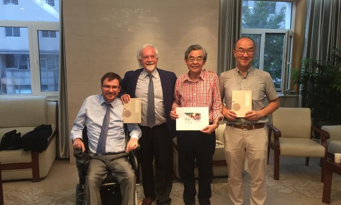 IDA delegation meeting with China Association. From left: Vladimir Cuk (IDA Executive Director), Klaus Lachwitz (IDA Secretary General), Zhang Baolin (China Association), Nagase Osamu (Inclusion International).