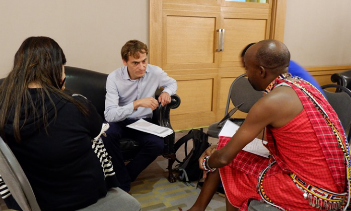 Representatives from UNHCR discussing with a small group of Bridge participants