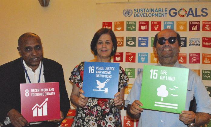Arab Organisation of Persons with Disabilities representatives with SDG signs