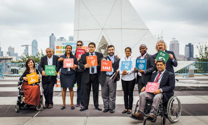 Stakeholder Group with SDG signs
