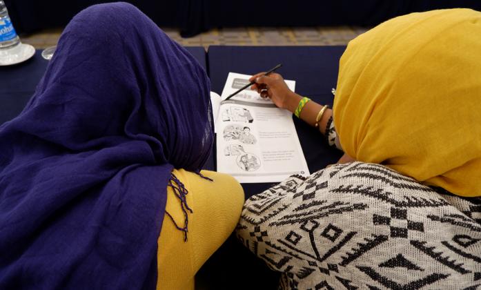 Bridge participants reading plain language materials