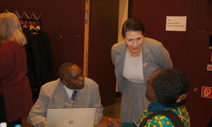Senator the Hon Concetta Fierravanti-Wells, Australian Minister for International Development and the Pacific speaking with Samuel Kabue, African Disability Forum
