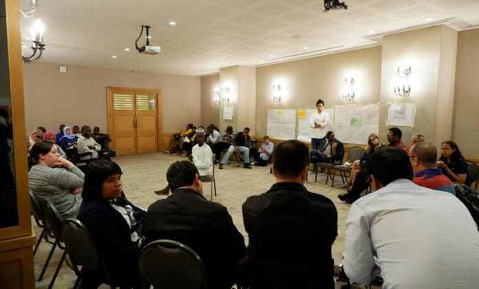 Participants discussing in the plenary