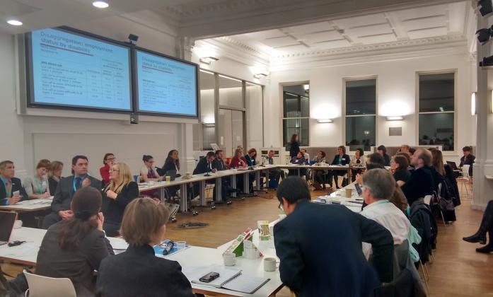 Conference delegates sat at a large rectangular table