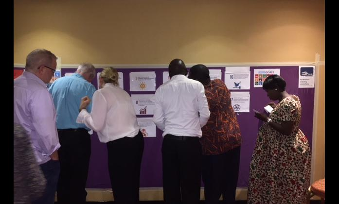 Participants of the WFDB workshop working at the sticky wall