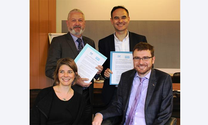 Manuel Patrouillard and Priscille Geiser from Handicap International with Colin Allen and Vladimir Cuk from the International Disability Alliance at the signing of the MoU.