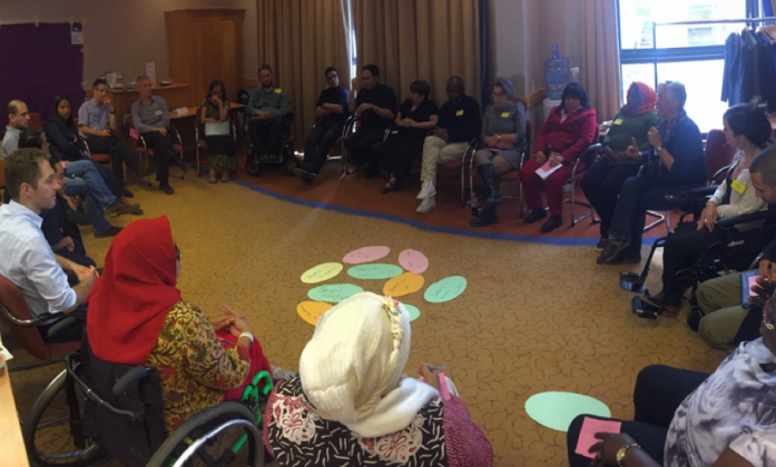 Trainees sit in a circle during the session on the importance of inclusive participation,