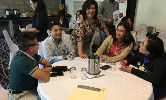 Delegates at a training smiling to camera