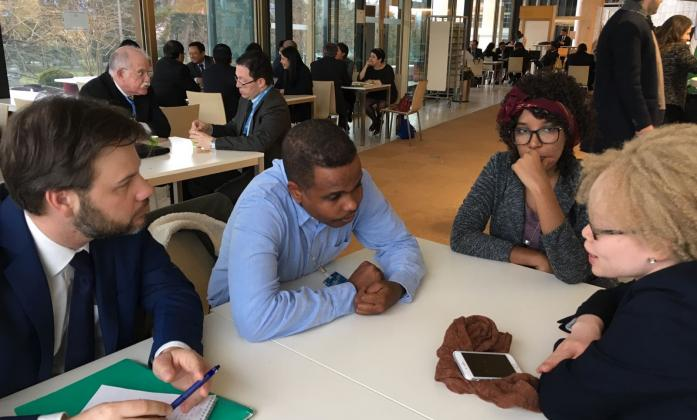 Alradi Abdallah from Sudan meeting with Ikponwosa Ero, the UN Independent Expert on the enjoyment of human rights by persons with albinism and other delegates at the United Nations in Geneva.