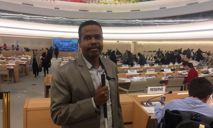 Alradi Abdallah from Sudan at the Human Rights Council Chamber at the United Nations in Geneva.