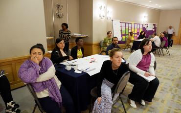 Participants listening to Abner explaining