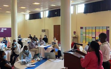 Facilitators speaking to the participants