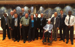 CRPD Committee members stand in the conference room at the UN in Geneva on the last day of the 18th CRPD Session